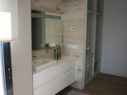 The bedroom has its own bathroom and dressing room